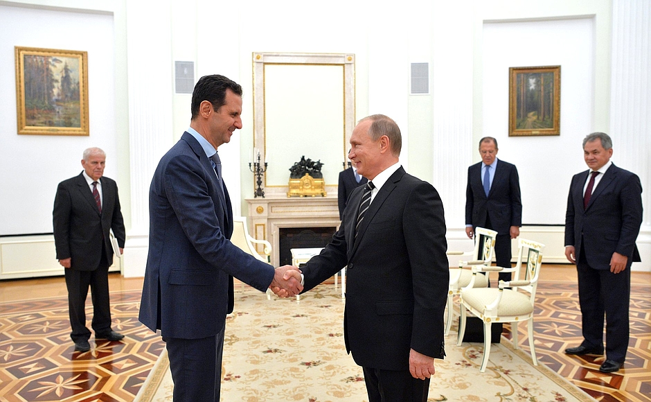 Russian President Vladimir Putin and Syrian President Bashar al-Assad shake hands in Moscow in October 2015. (The Kremlin)