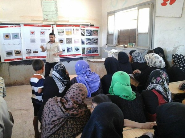 Women learning to demine in Syria